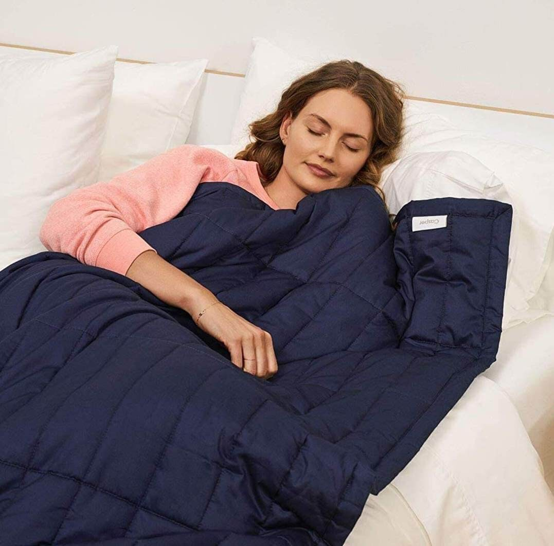 Woman sleeping peacefully with blanket