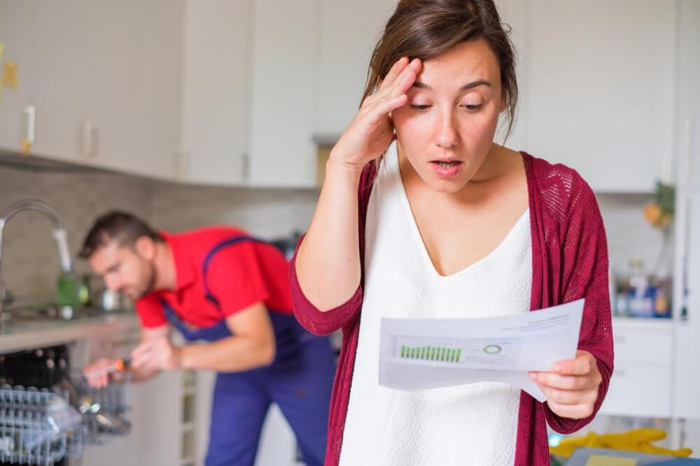 Woman looking aghast at her repair bill