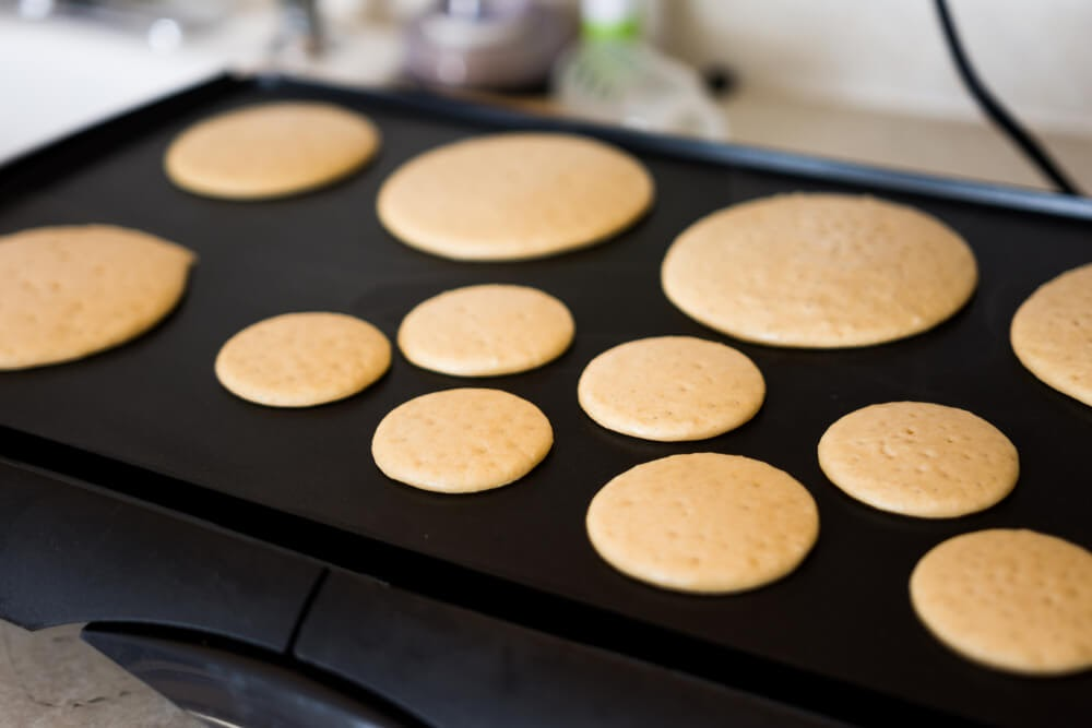 Griddle full of delicious but tiny pancakes