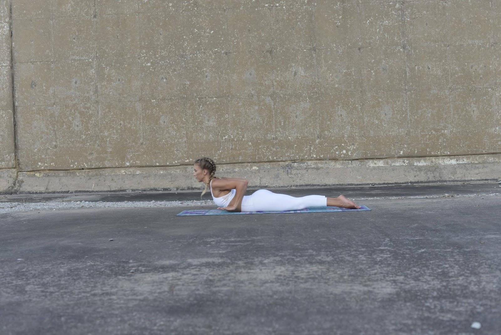 Woman doing low cobra