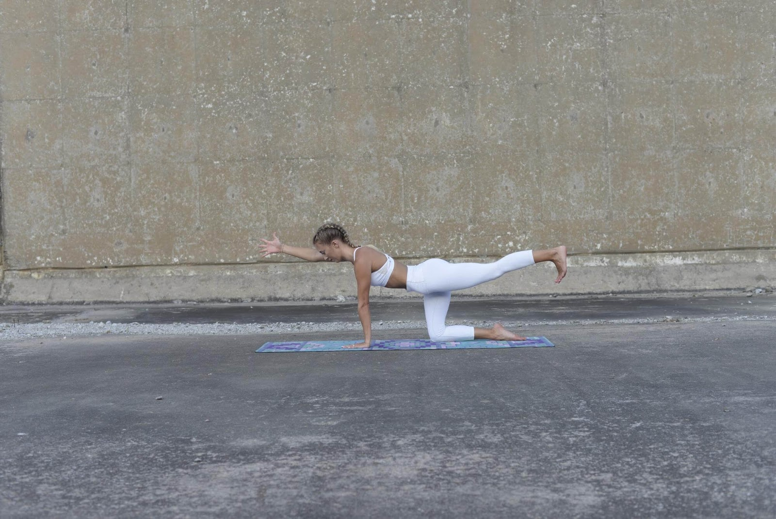 Woman in spinal balance pose