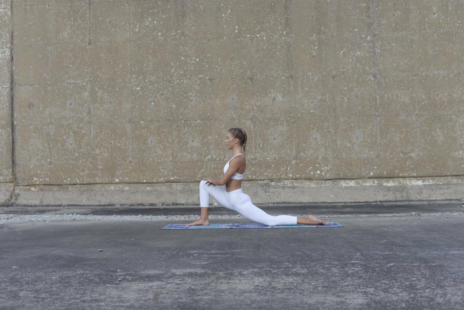 Woman in half kneeling position