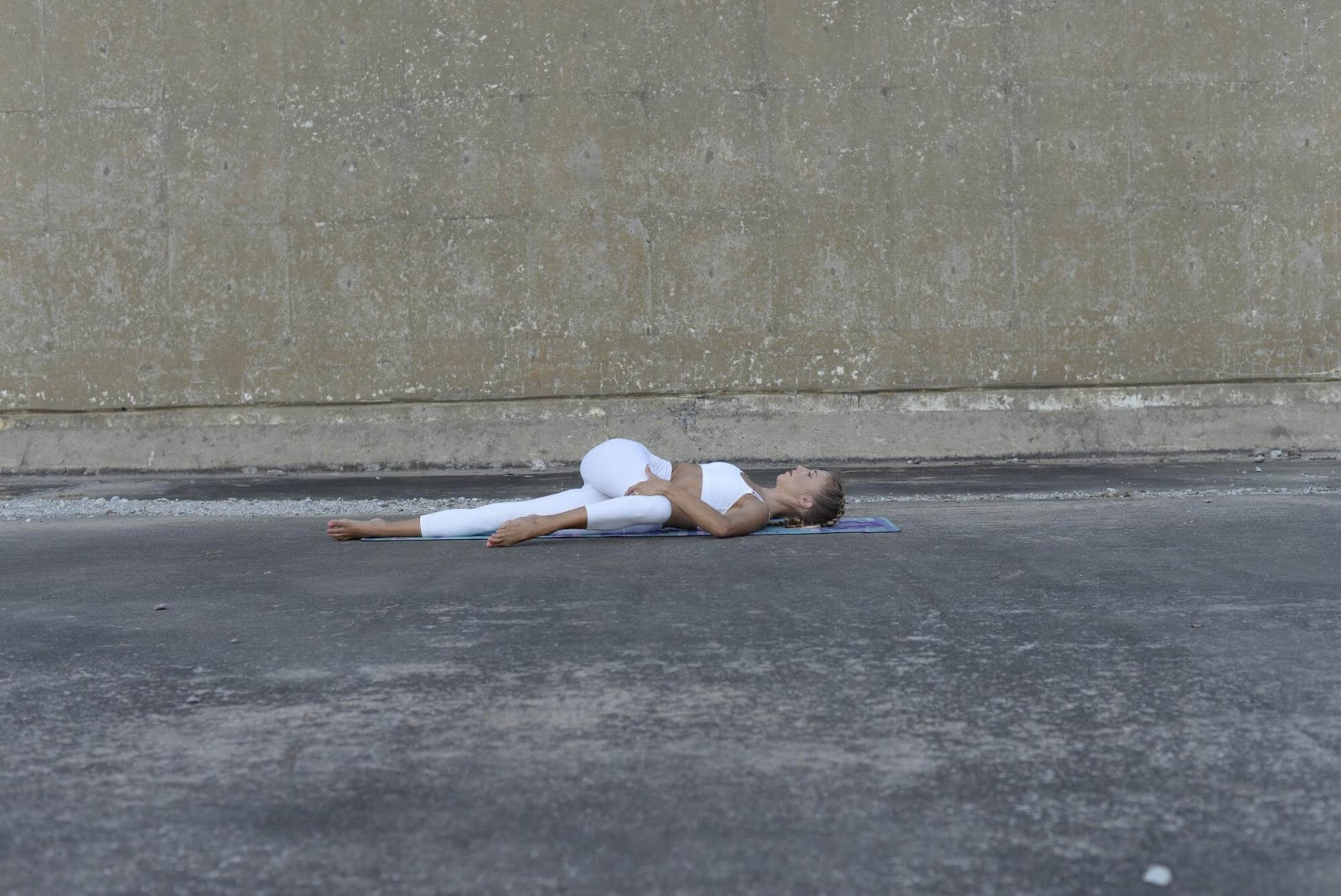 Woman in Spinal Twist position