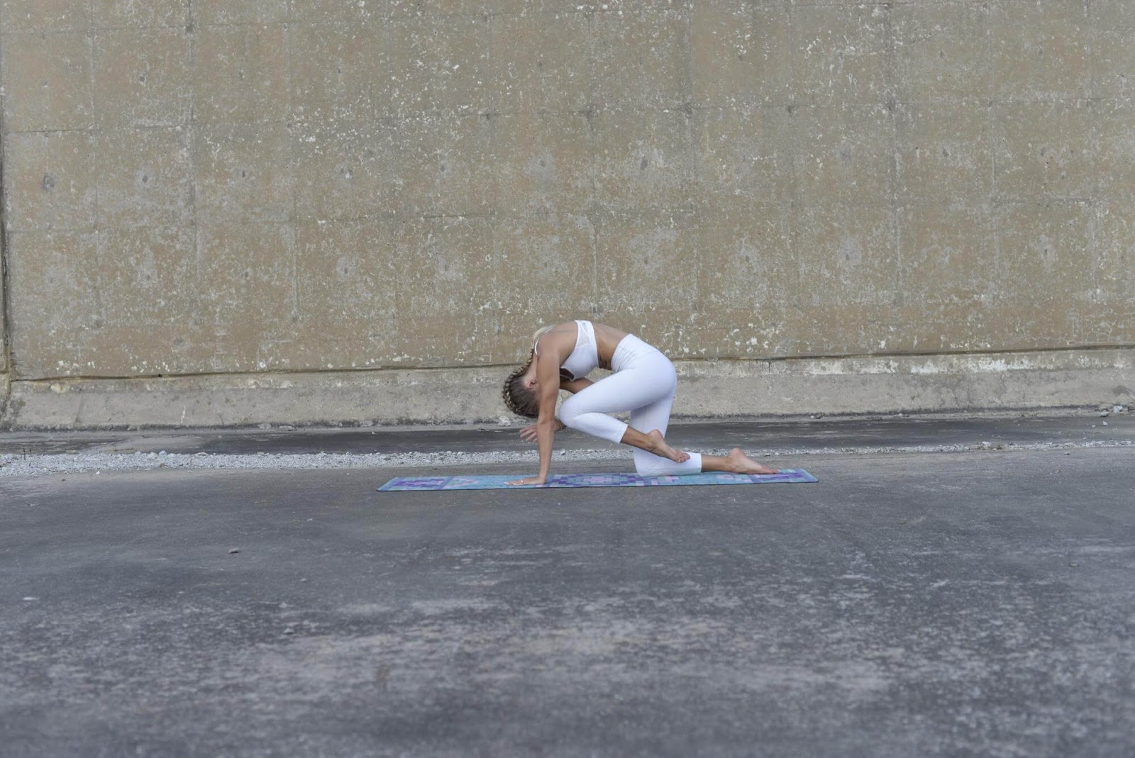 Woman in curled spinal balance position