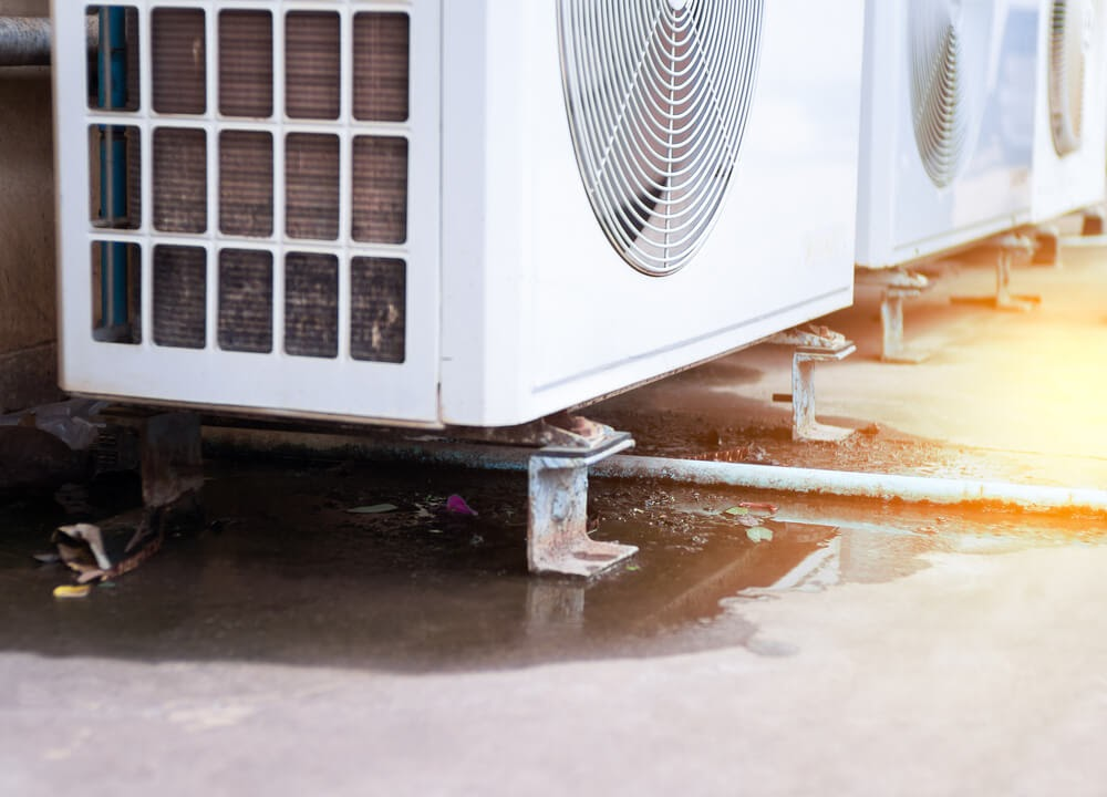 Close up of rusty a/c unit bottom caused by a leak
