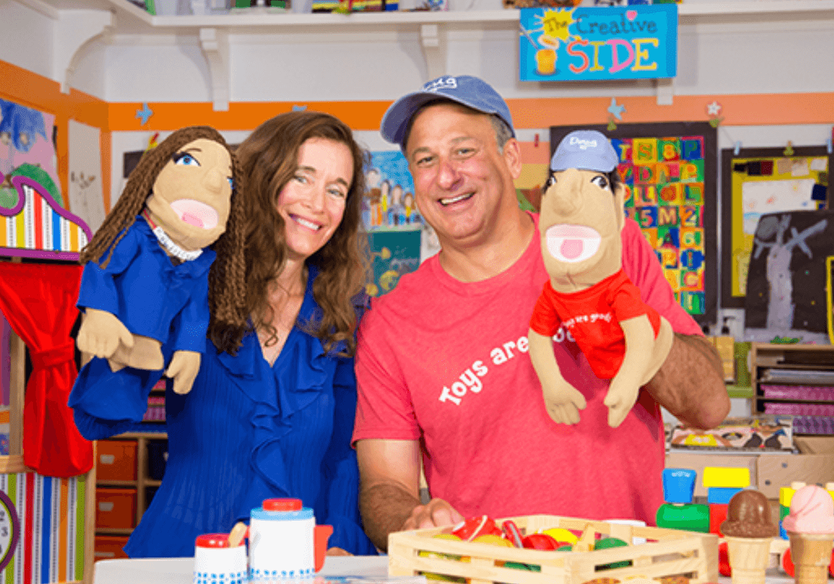 The actual Melissa & Doug with their look-alike puppets.