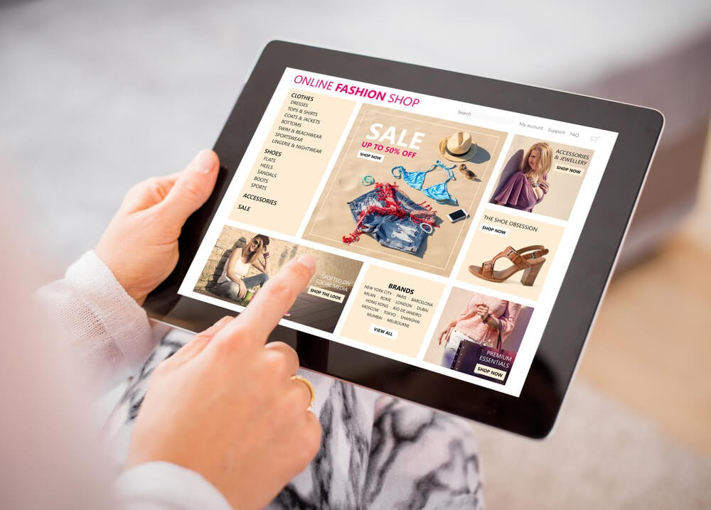 Woman shopping  for some clothes on her tablet