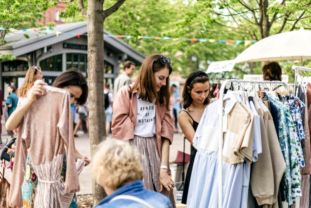 Ladies looking at clothes in a flea market