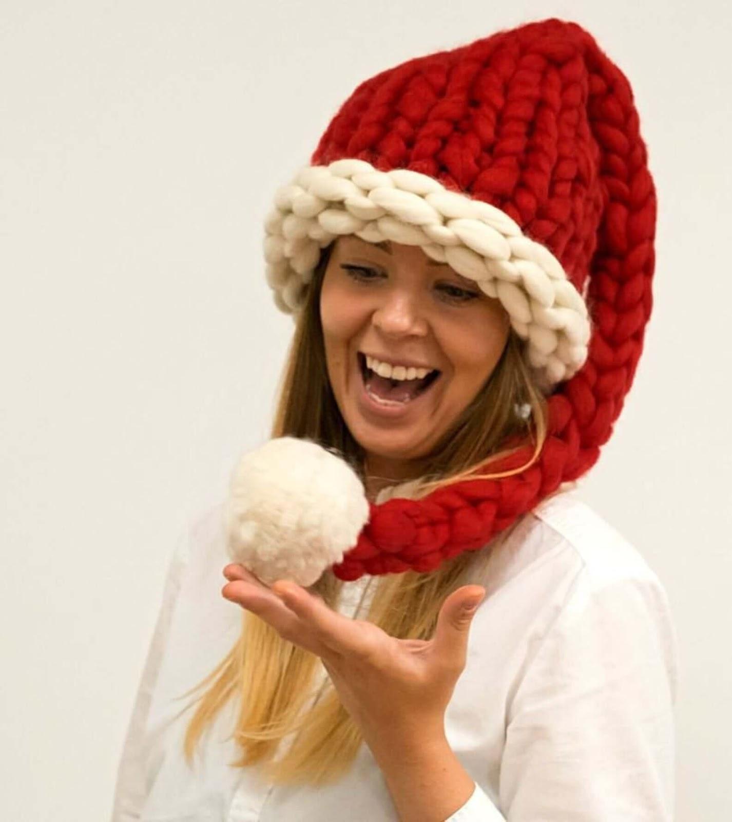 Woman rocking a chunky knit Santa hat