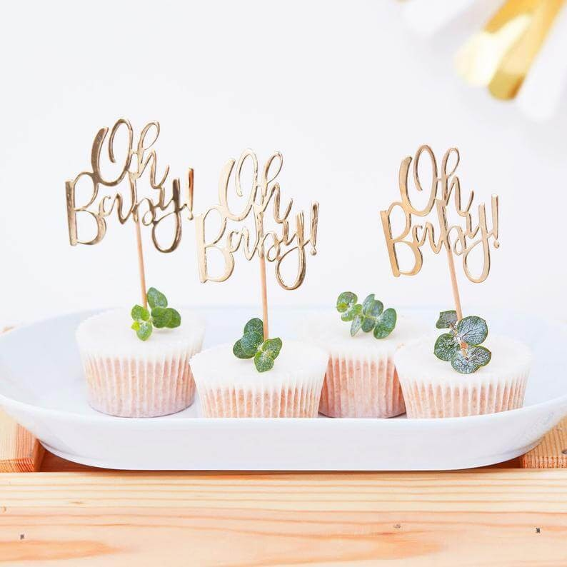 "Cupcakes with ""Oh Baby"" toppers"