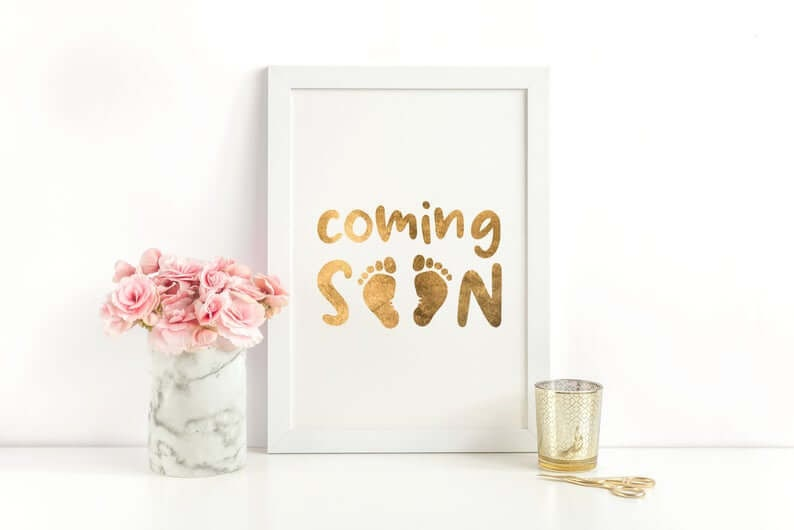 "Picture saying ""Coming Soon"" with baby footprints"