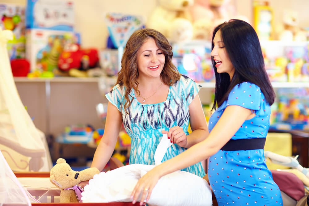 Two women shopping at a baby store
