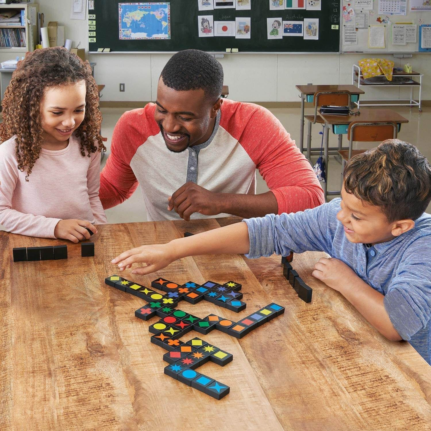 Teacher and two students playing dominoes