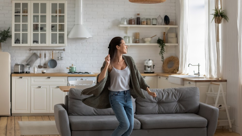 Woman dancing in the living room