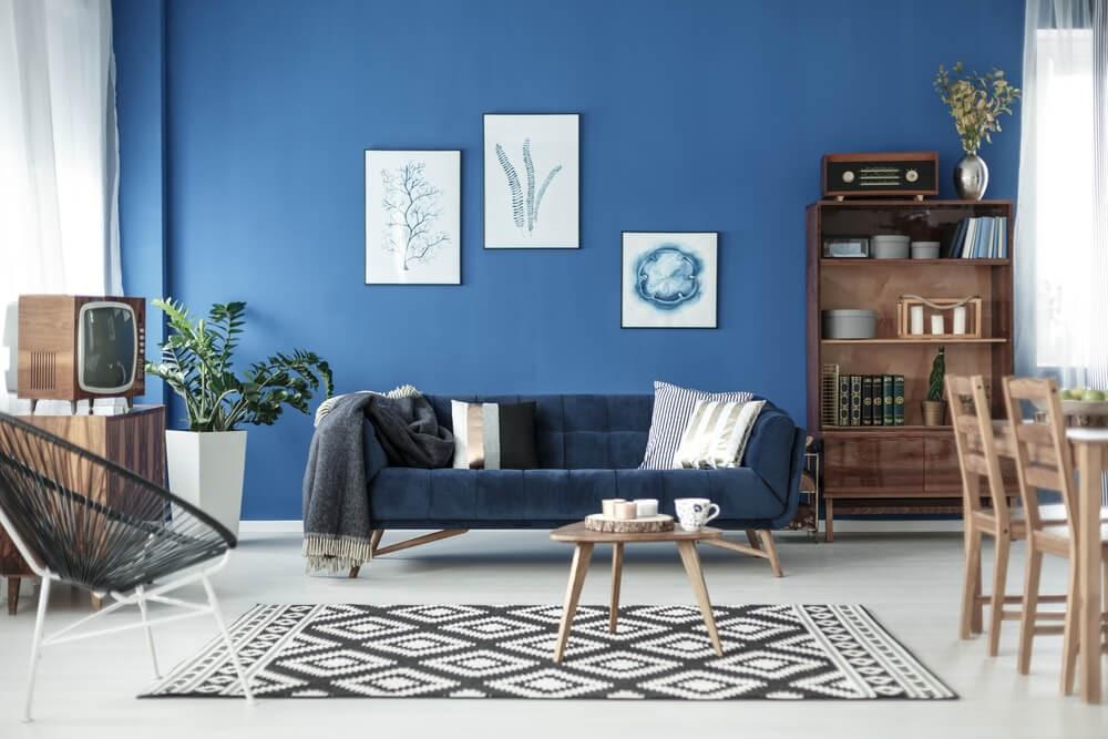 Mid-Century Modern living room against blue wall