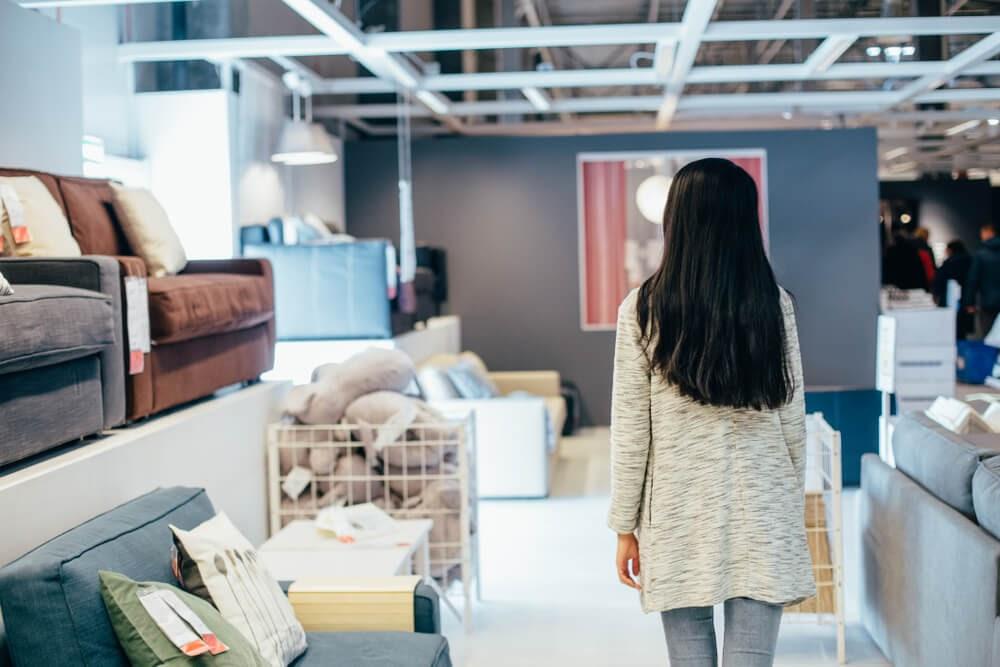 Woman walking through furniture store