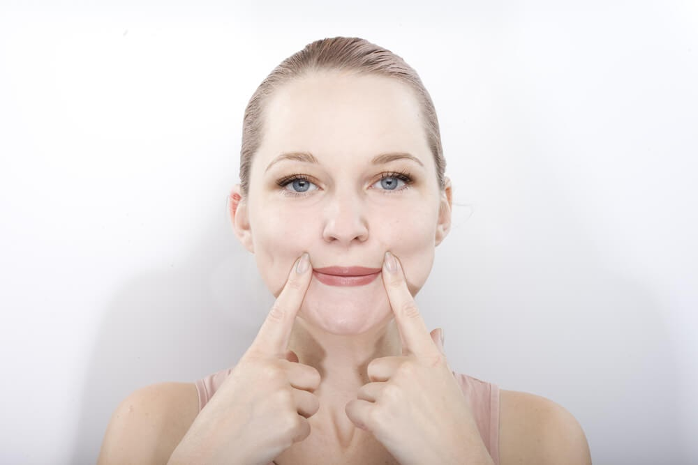 Woman pressing on the corners of her lips