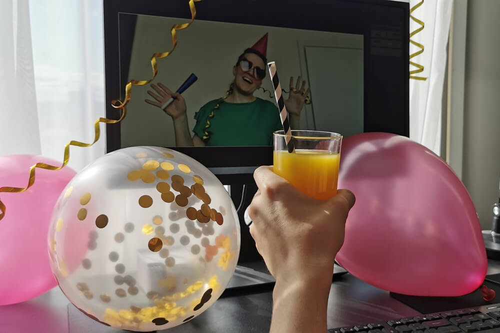 Balloons and streamers surrounding a virtual party