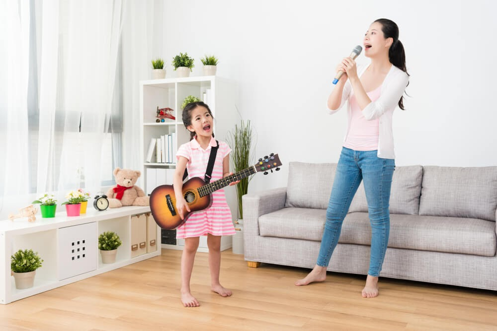 Mom and daughter playing in a band in their living room
