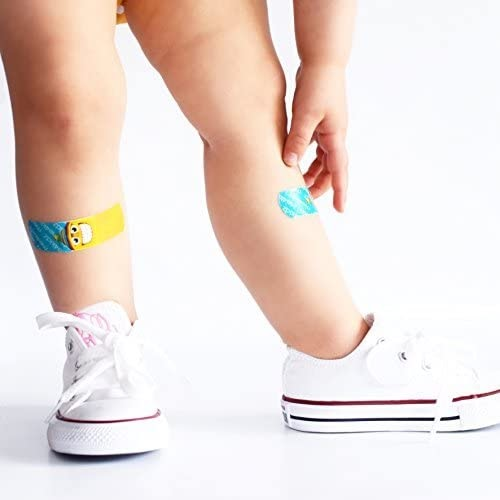 Kids legs with bandages