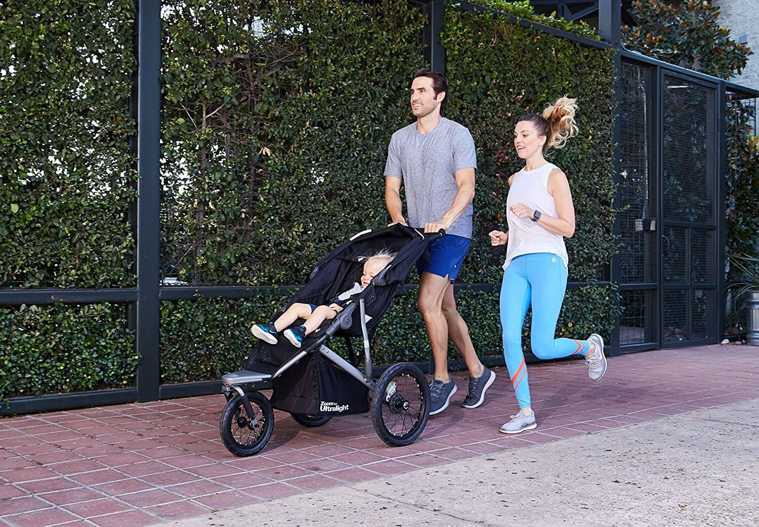 Couple running with stroller