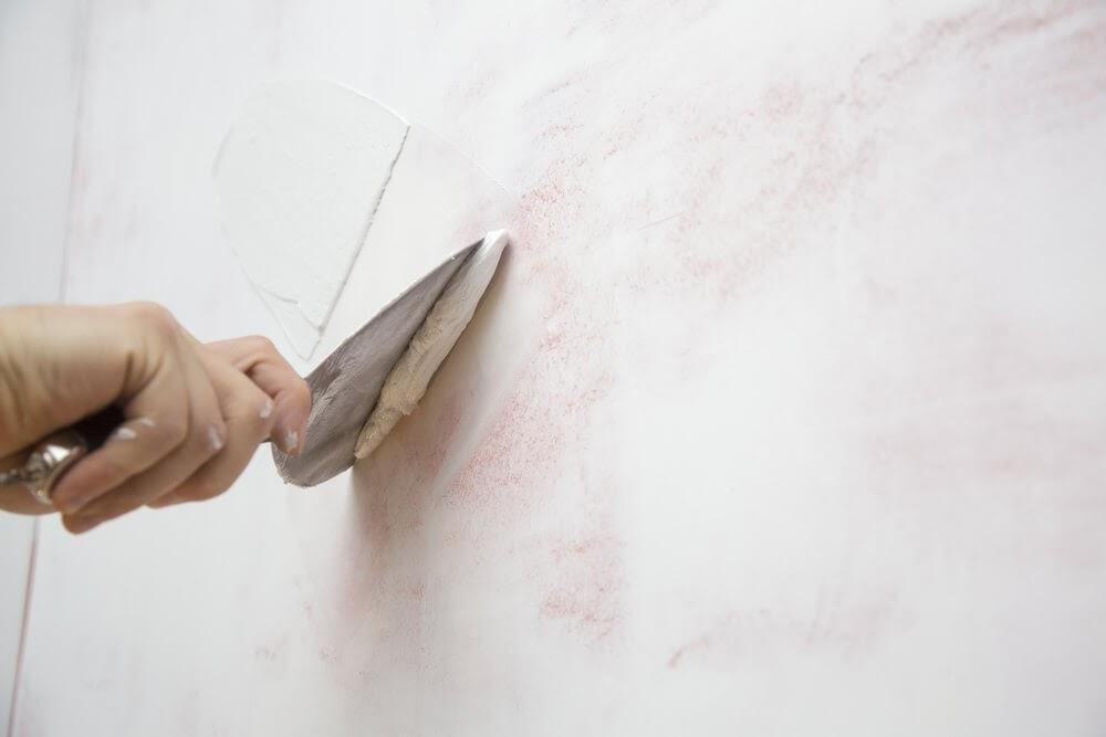 Close up of someone plastering the wall