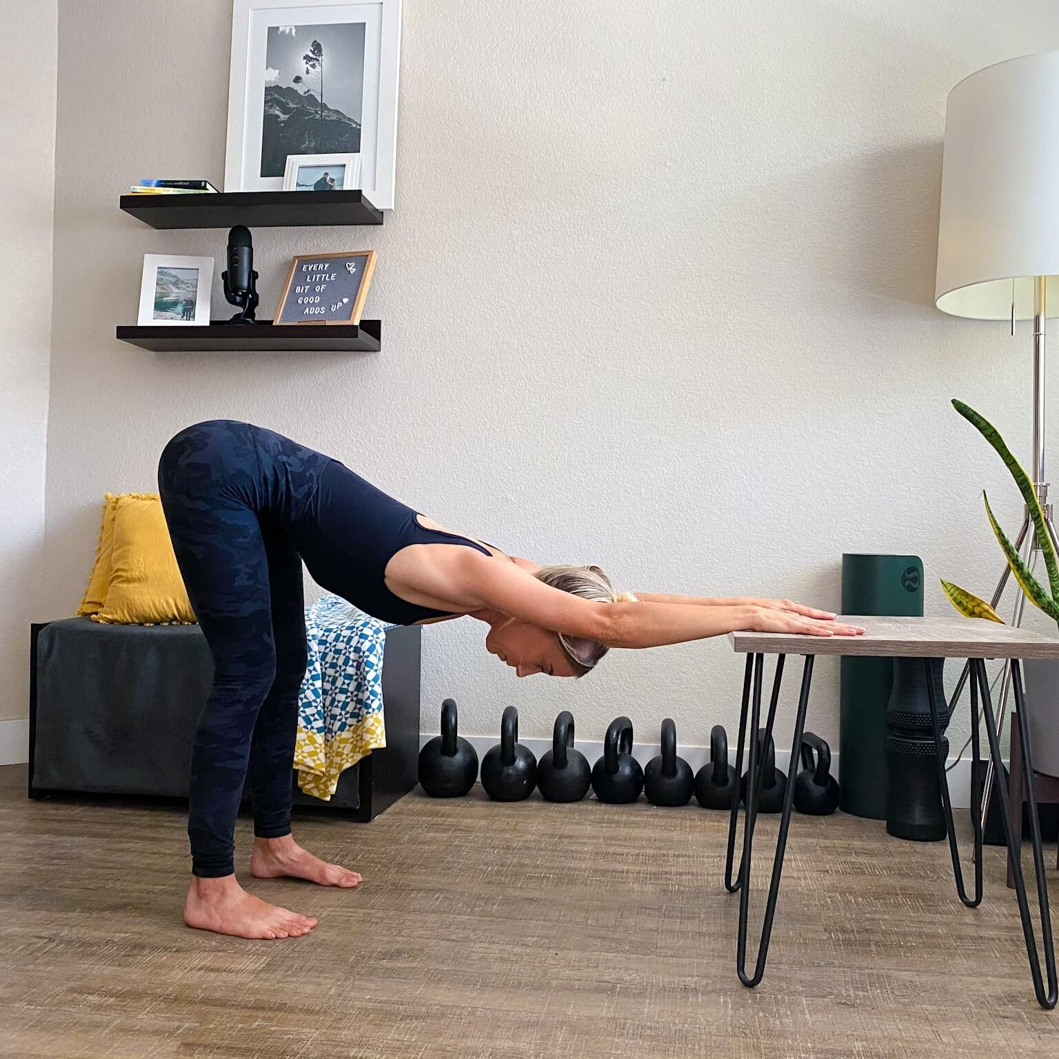 Modified downward dog standing and using desk