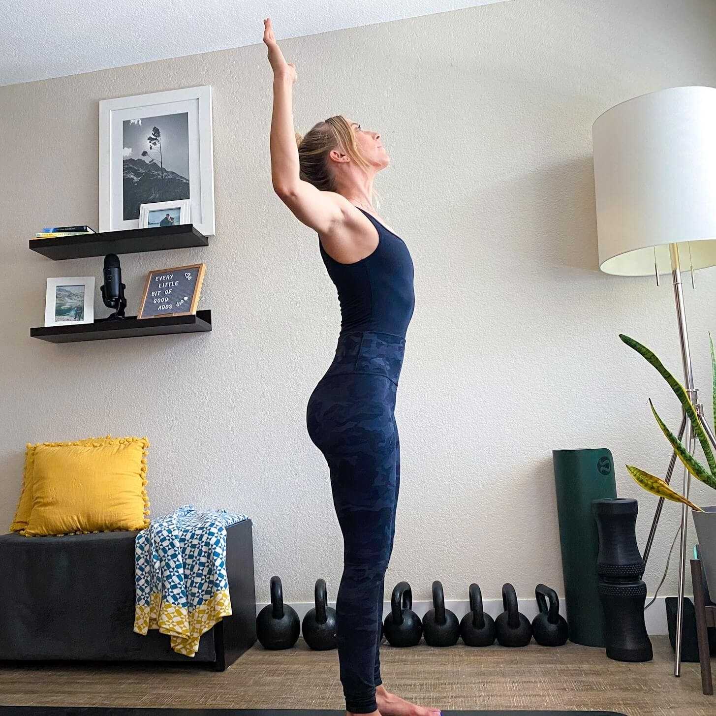 Emily standing on her mat with catcus arms