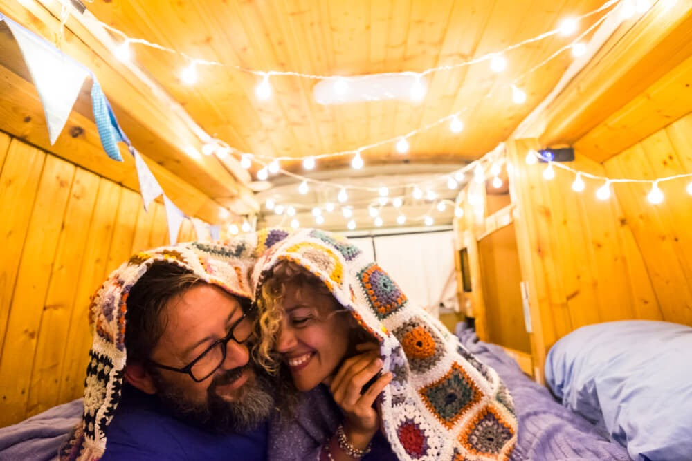 couple under a blanket in a tiny home