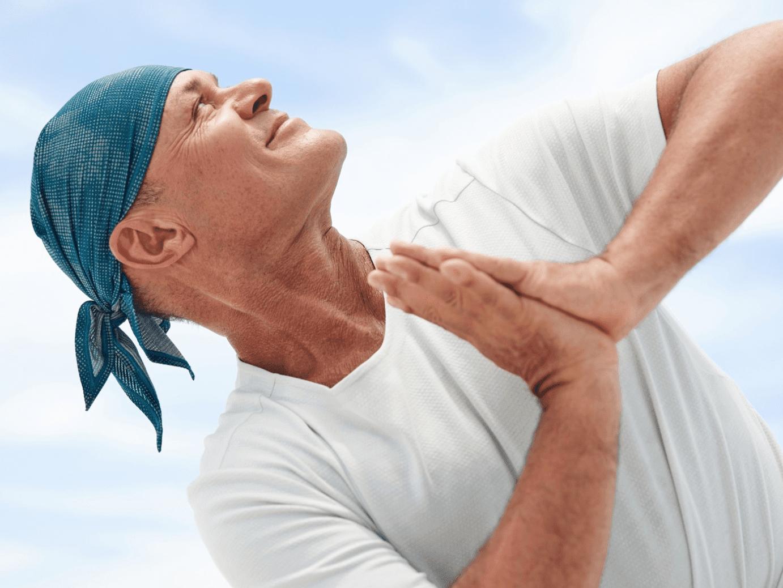 older man doing yoga