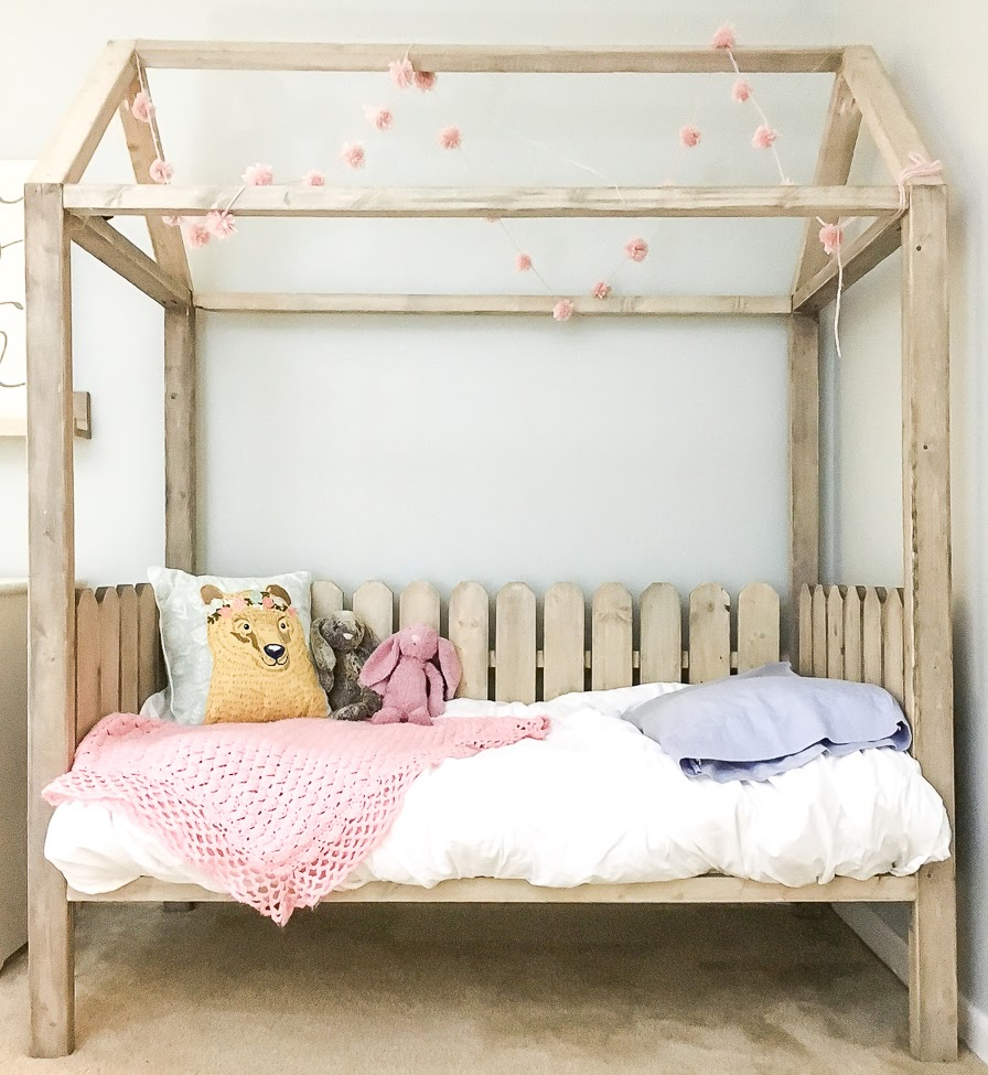 Toddler bed with wooden frame