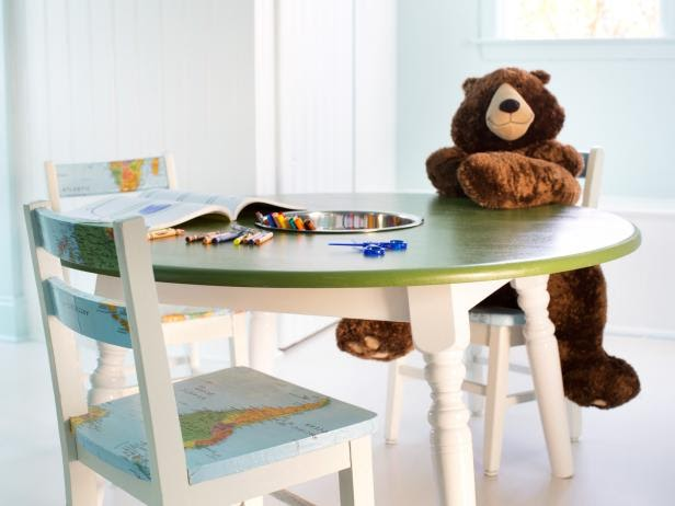 Child table with chairs covered in a world map