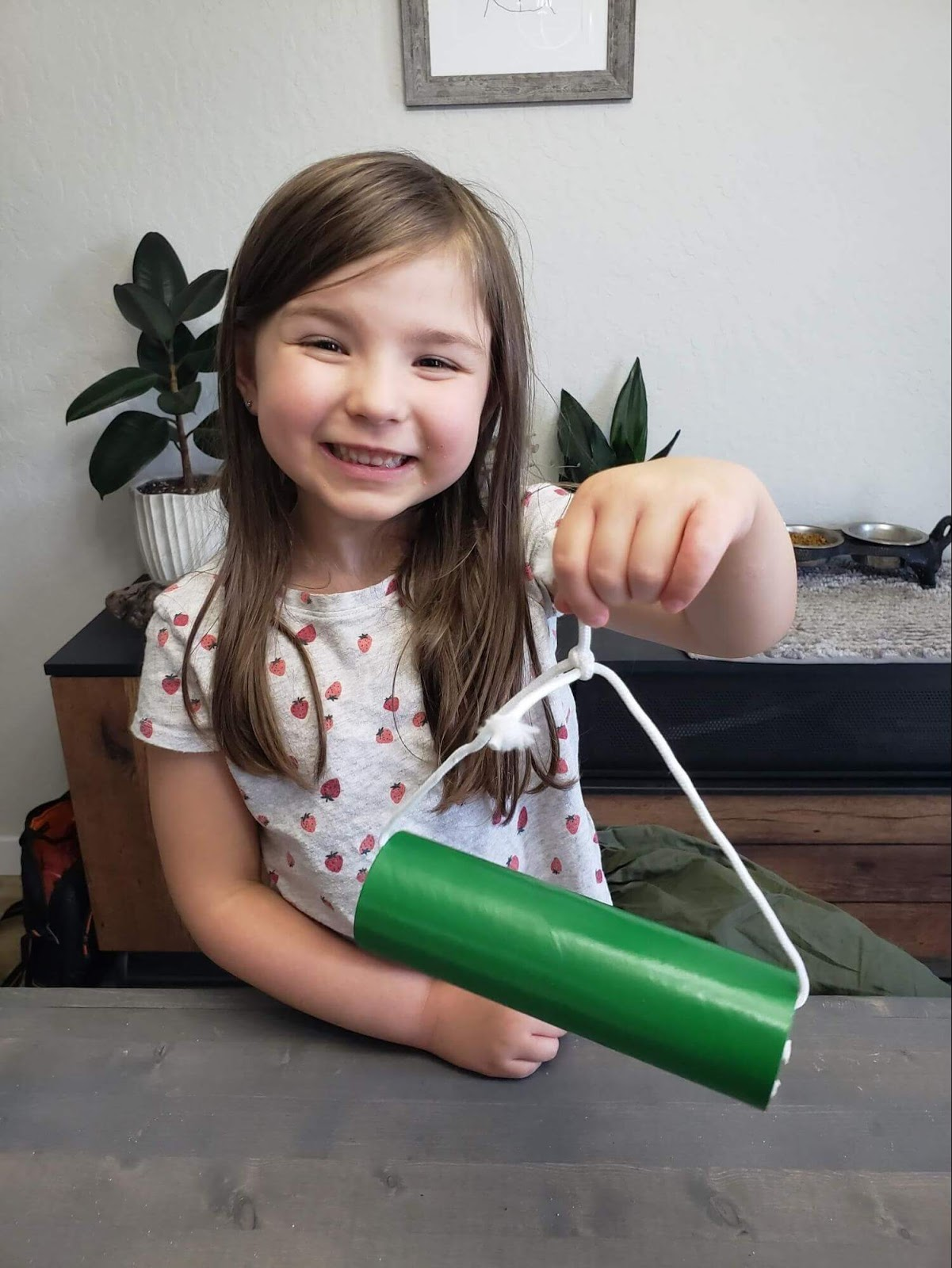 Girl holding up completed mason bee home