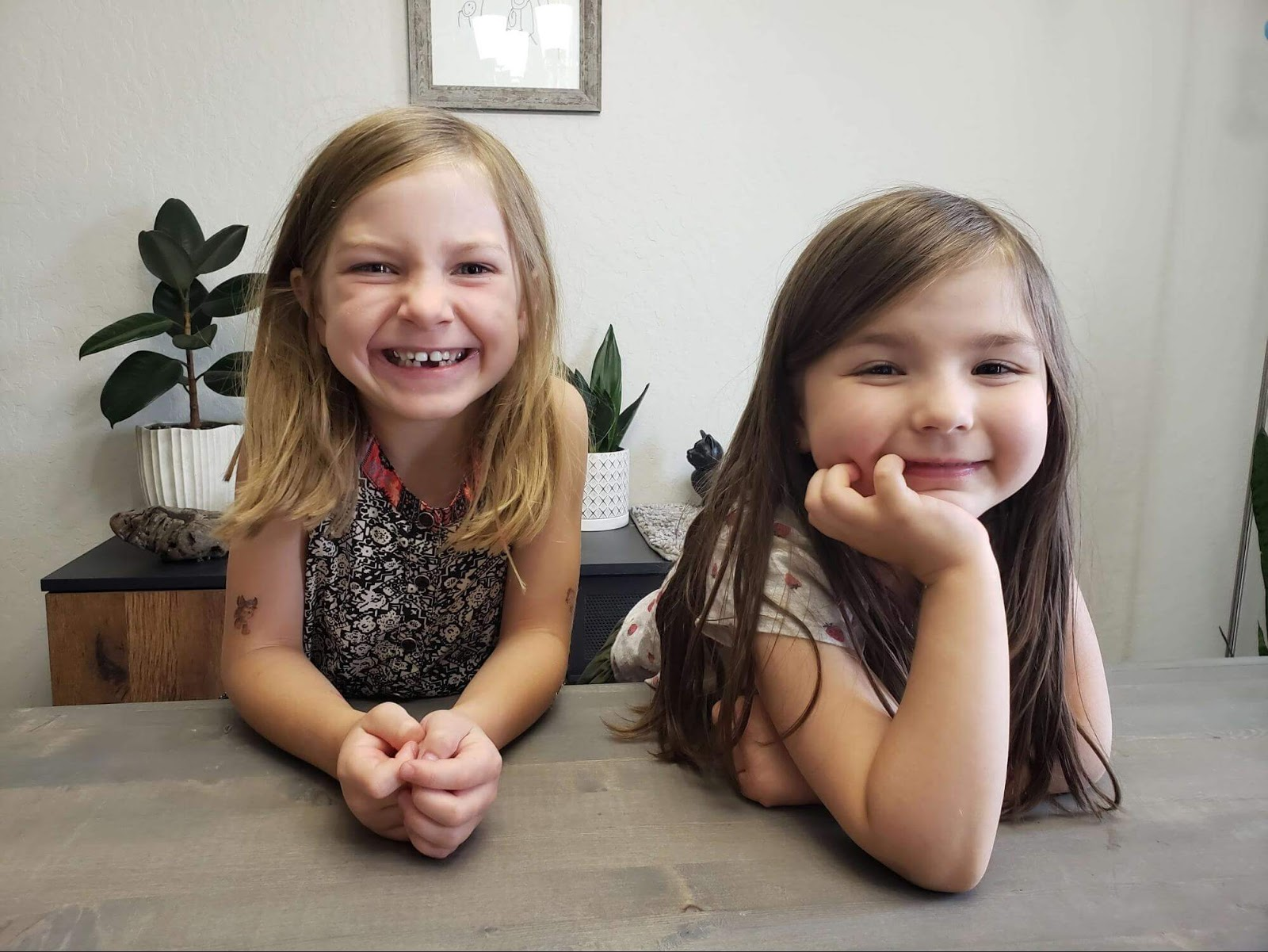 Two Girls smiling at the camera