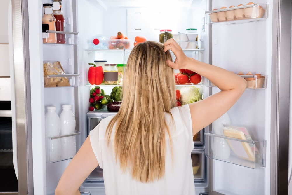 Woman looking in fridge