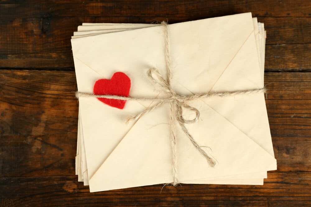 envelopes wrapped in twine with red felt heart