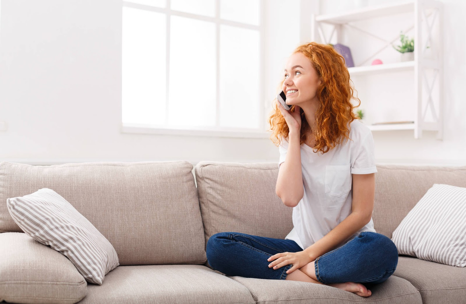 Woman talking on her cell in her living room