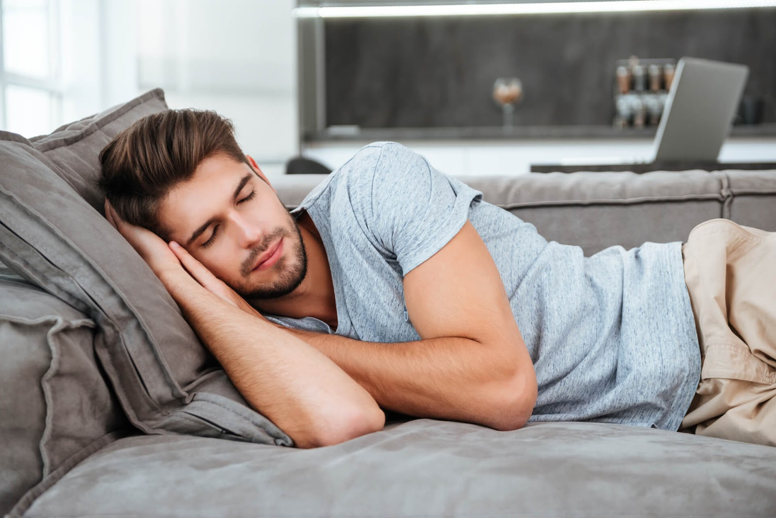 Man snoozing on couch