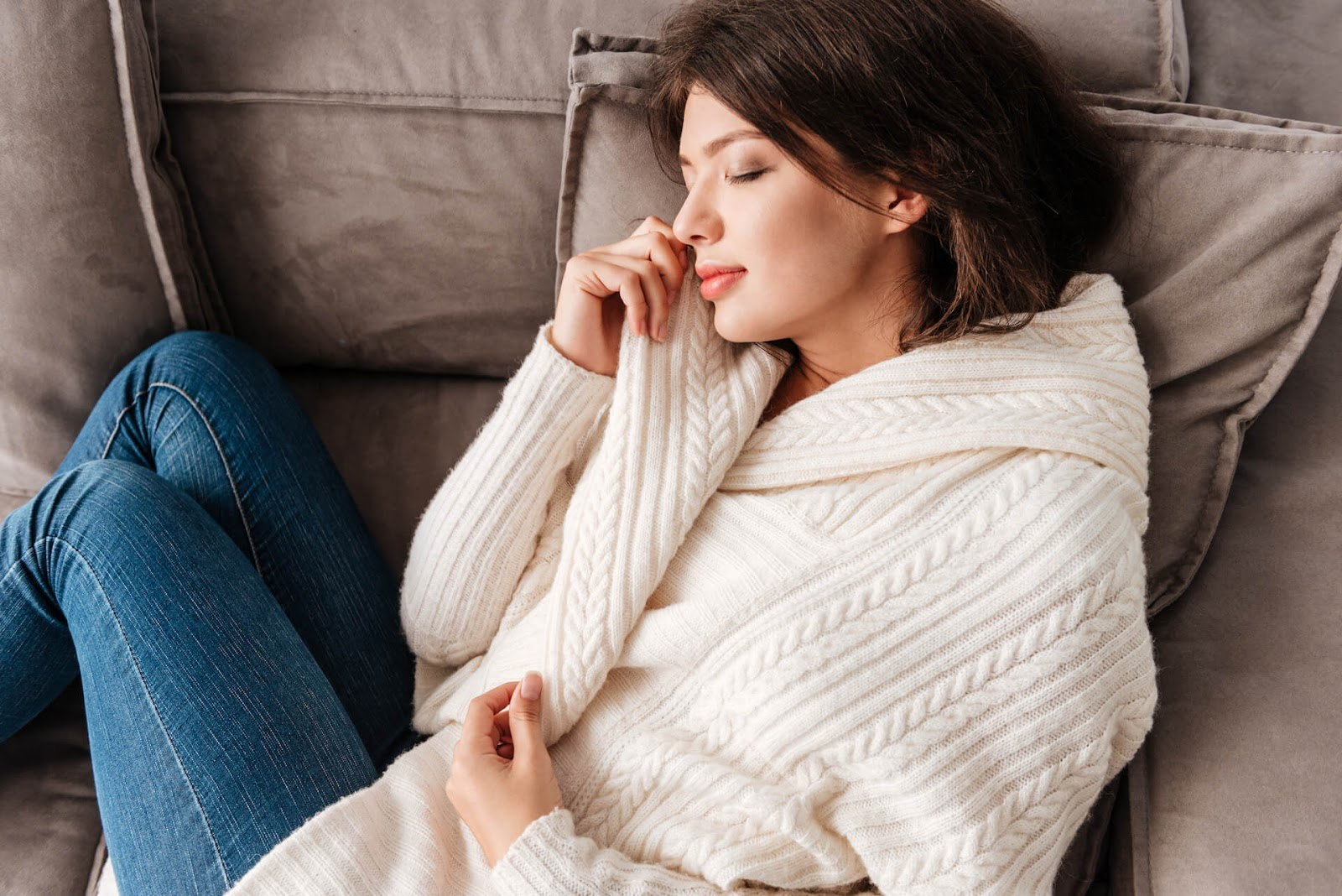 Woman cuddled up on couch