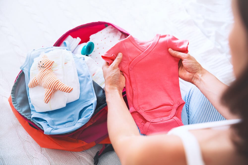 Woman packing her baby bag