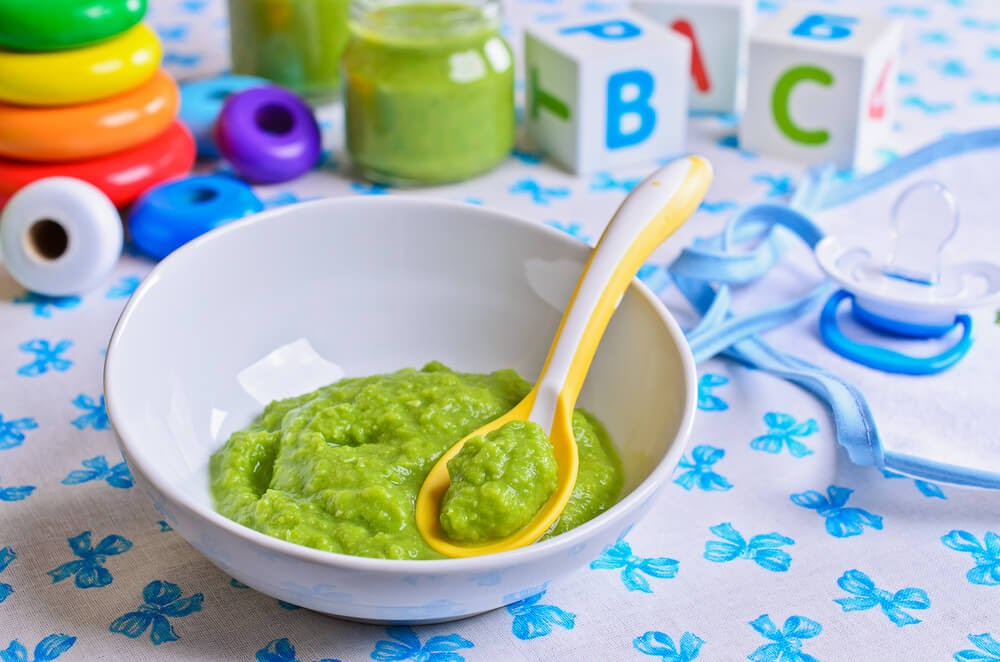 Close up of mashed up avocado in a baby bowl