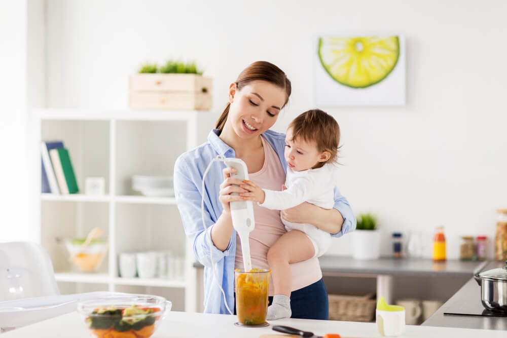 Mom and baby pureeing food together