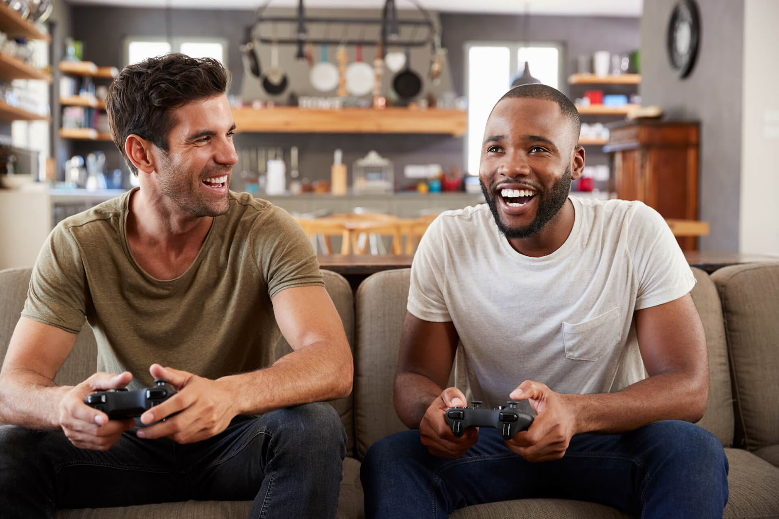 Two men playing video games together