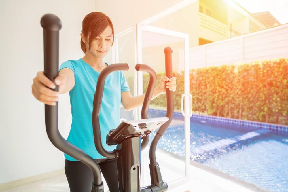 Woman exercising on an elliptical