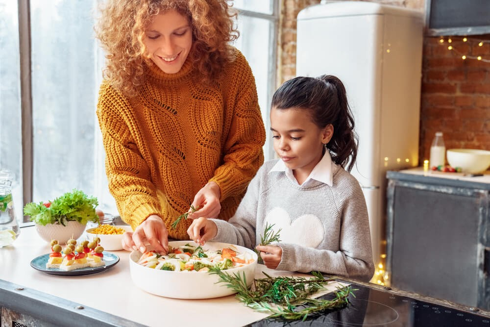 Young woman and child preparing a Thanksgiving dish