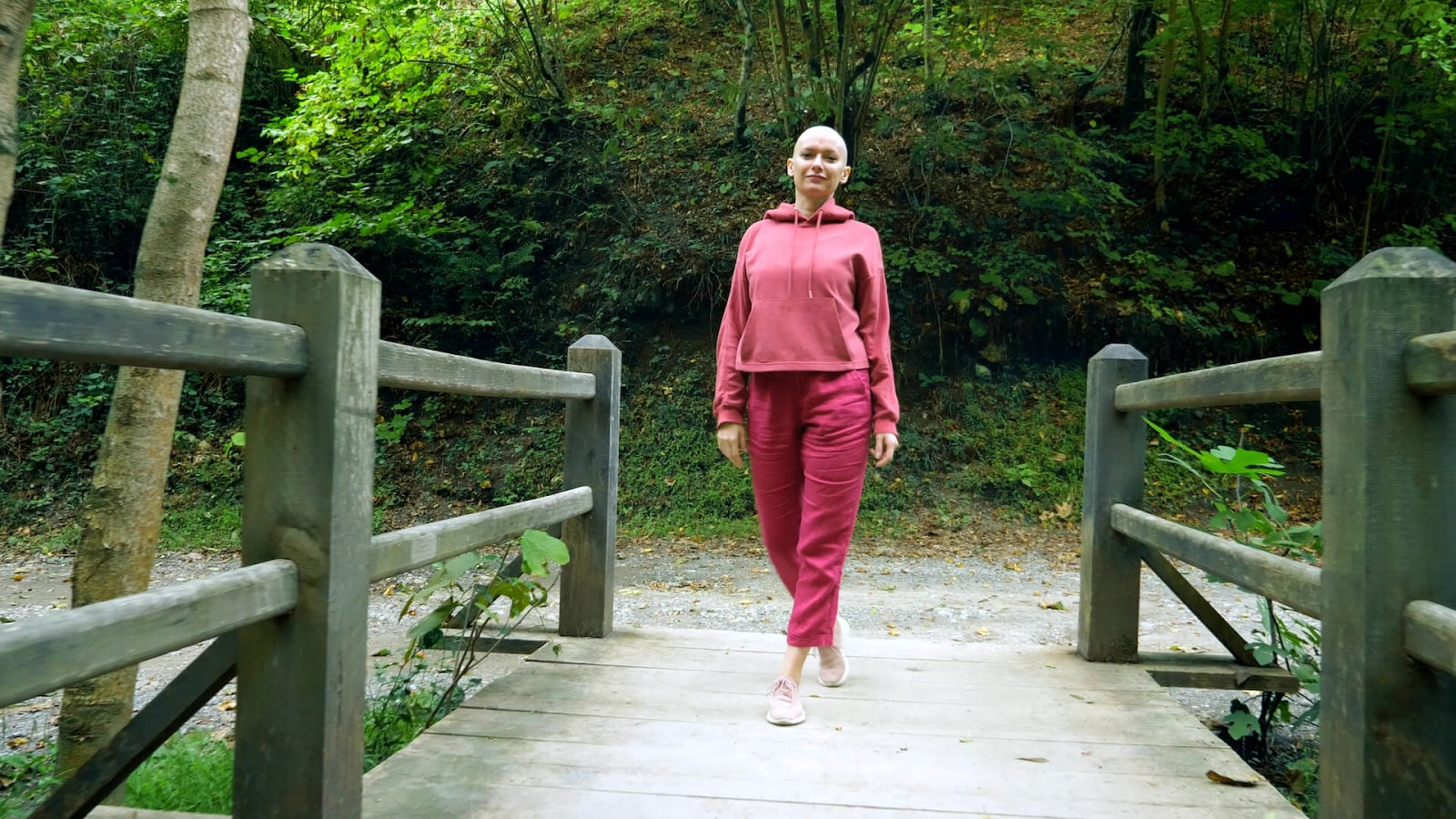 Woman with cancer walking through the park