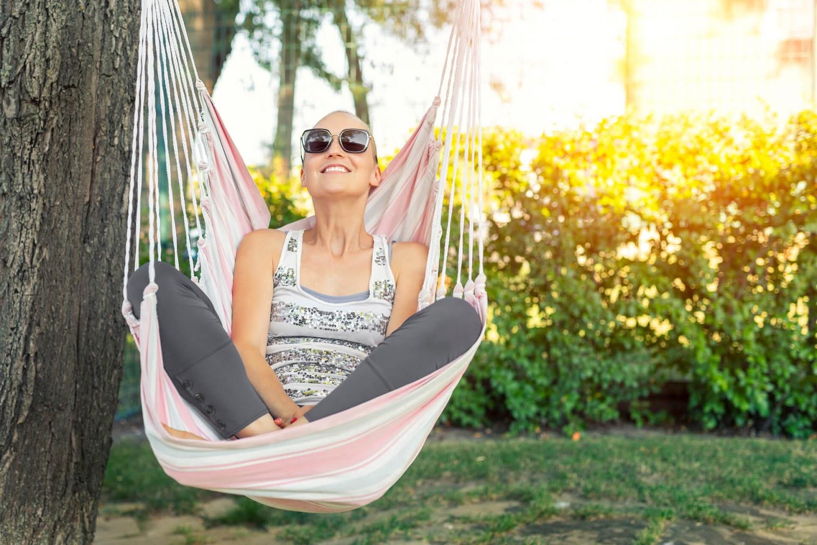 Bald woman smiling in hammock chair