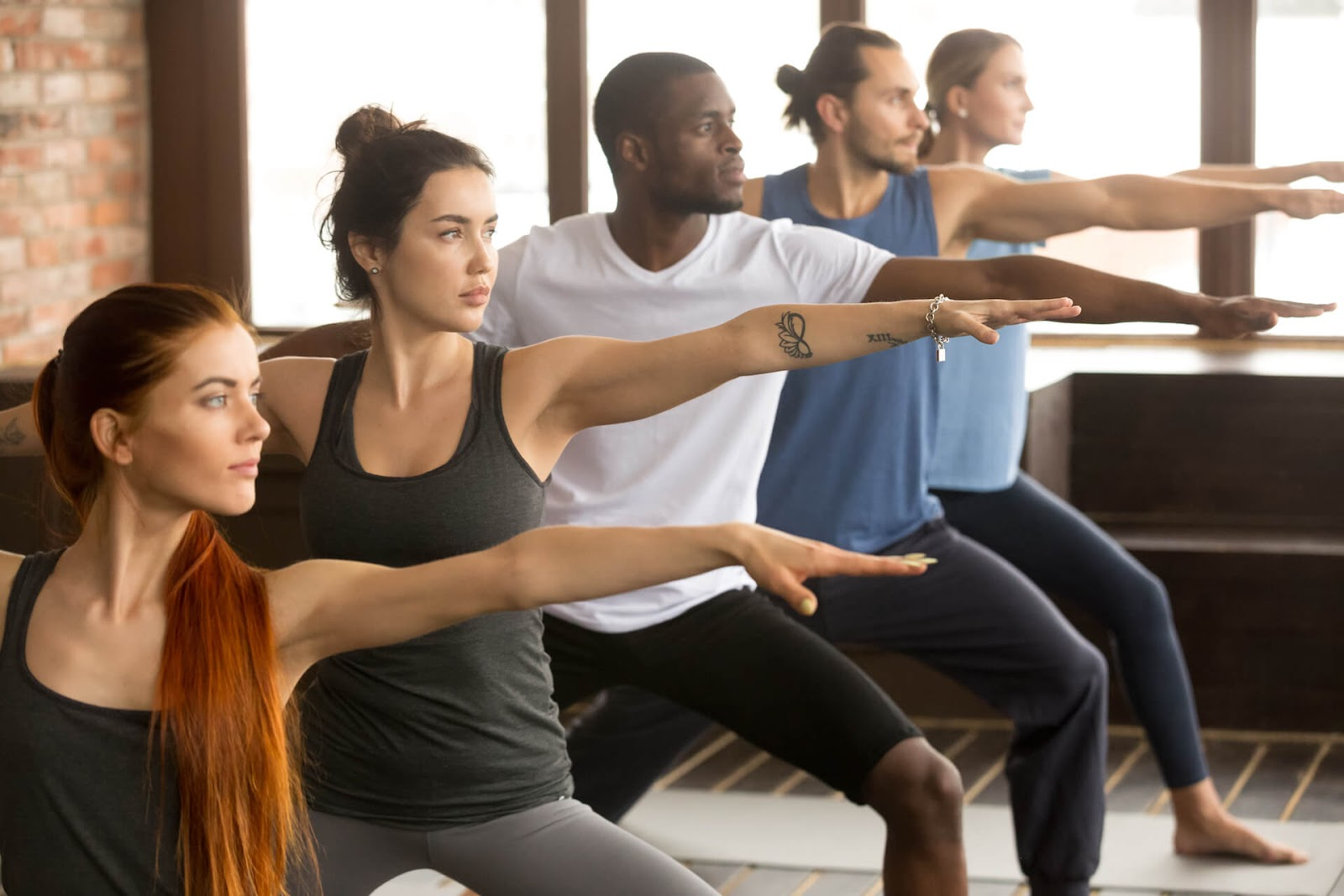 Group of people doing yoga in a studio