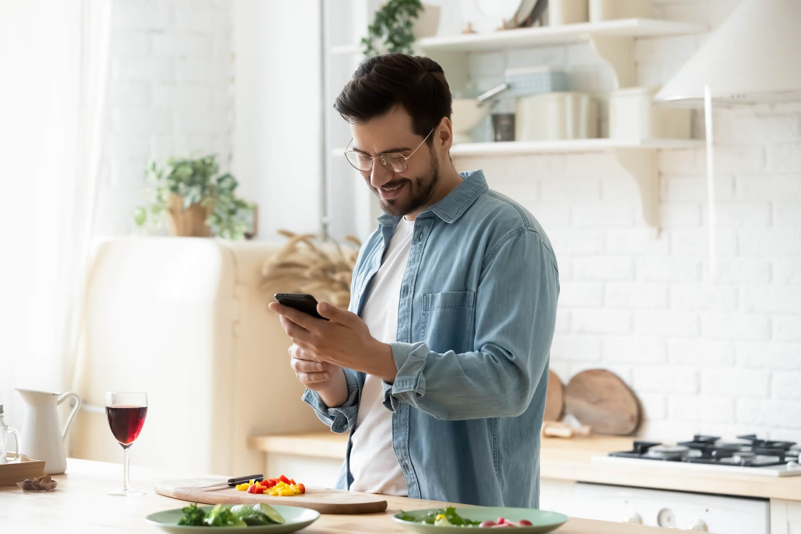 Man shopping for wine on his phone