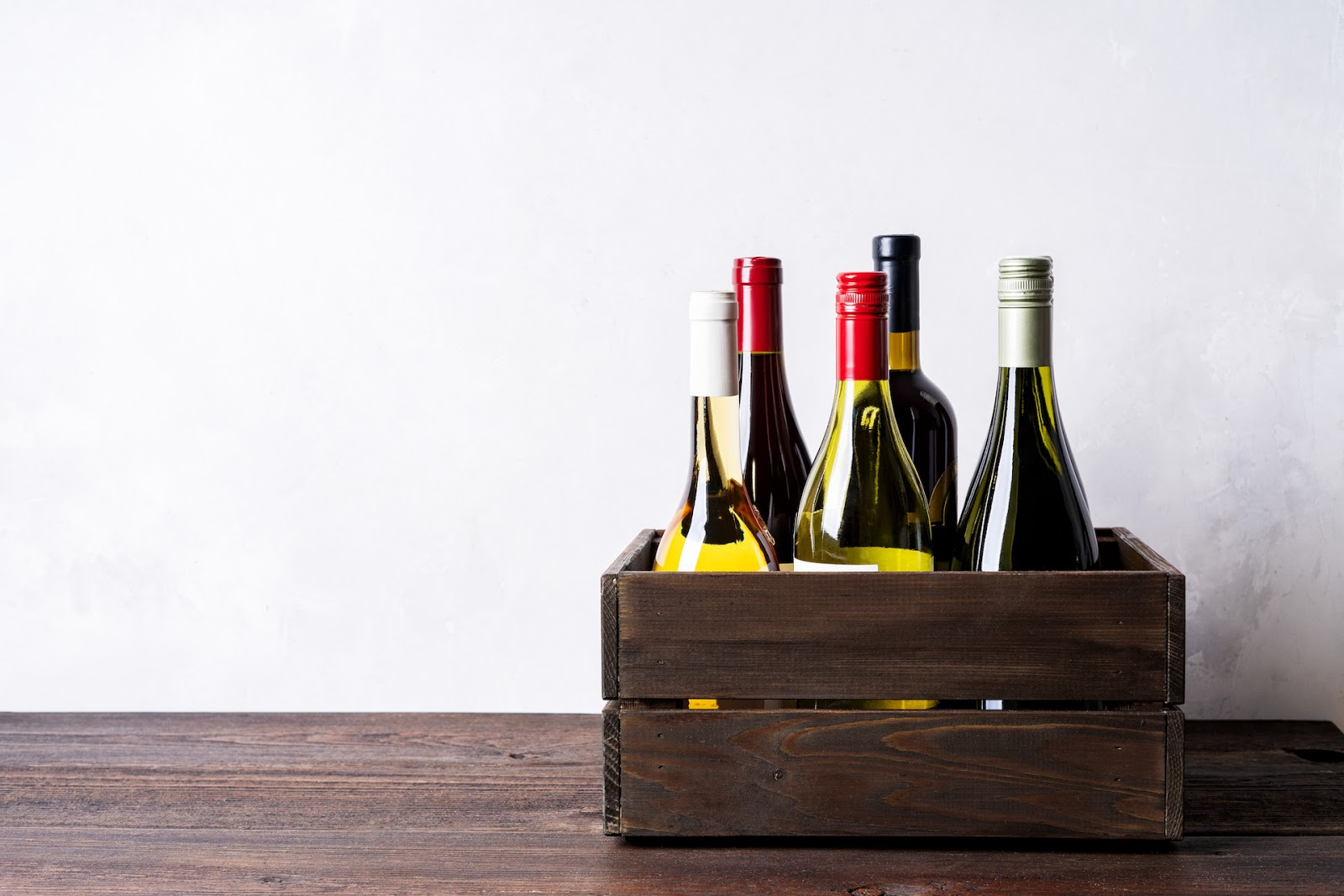 5 Bottles of wine in a crate